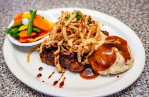 steak topped with fried onion